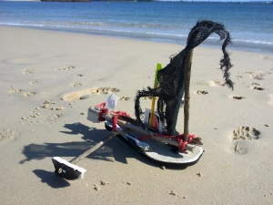 flotsam rubbish sailing boat